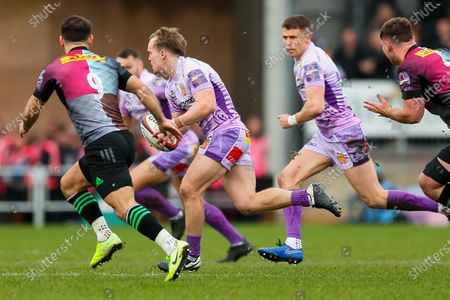 Stuart Townsend of Exeter Chiefs is challenged by Danny Care of Harlequins