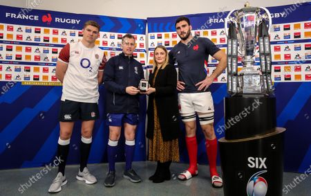 France vs England. England captain Owen Farrell with referee Nigel Owens, Kate Moore of Diageo and France captain Charles Ollivon