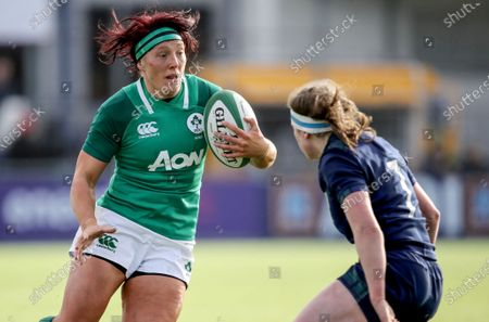 Stock Image of Ireland Women vs Scotland Women. Ireland's Lindsay Peat comes up against Rachel McLachlan of Scotland