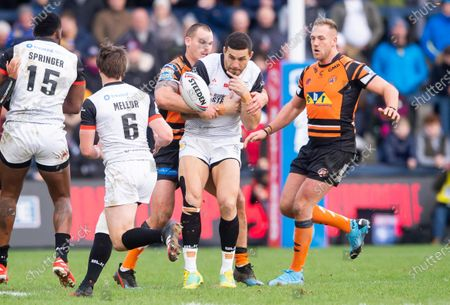 Toronto's Sonny Bill-Williams has the ball knocked loose on his first carry in the Betfred Super League by Castleford's Cheyse Blair.