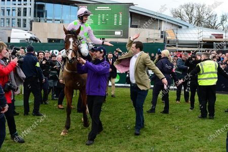 Leopardstown. Faugheen and Paul Townend are greeted by Joe Chambers racing manager for owner Rich Ricci in the winners enclosure.