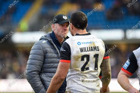 Toronto Wolfpack Head Coach Brian McDermott speaks Sonny Bill Williams of Toronto Wolfpack after the Betfred Super League match between Toronto Wolfpack and Castleford Tigers at Emerald Headingley Stadium, Leeds