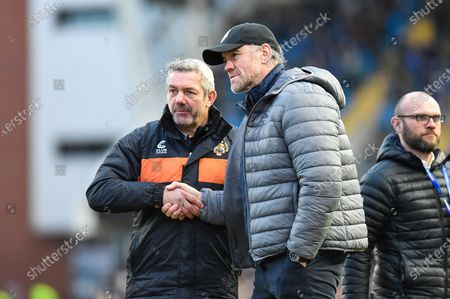 Toronto Wolfpack Head Coach Brian McDermott speaks with Castleford Tigers Head Coach Daryl Powell after the Betfred Super League match between Toronto Wolfpack and Castleford Tigers at Emerald Headingley Stadium, Leeds