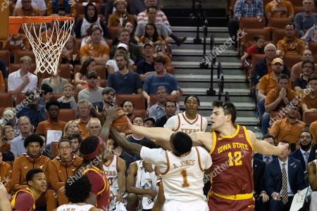 Andrew Jones, Michael Jacobson, Solomon Young. Texas' Andrew Jones, center, has his shot blocked by Iowa State's Michael Jacobson, right, and Solomon Young, left, during the first half of an NCAA college basketball game, in Austin, Texas. Texas won 72-68