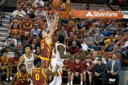 Michael Jacobson, Courtney Ramey. Iowa State's Michael Jacobson (12) blocks a shot by Texas' Courtney Ramey during the first half of an NCAA college basketball game, in Austin, Texas. Texas won 72-68