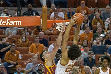 Jericho Sims, Michael Jacobon. Texas' Jericho Sims goes up for a dunk against Iowa State's Michael Jacobson during the first half of an NCAA college basketball game, in Austin, Texas. Texas won 72-68