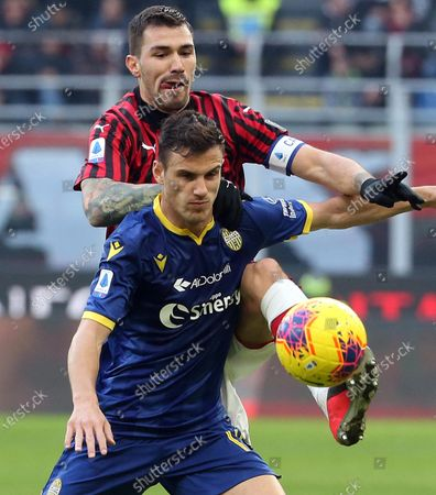 AC Milan's Alessio Romagnoli (top) challenges for the ball Verona's Valerio Verre during the Italian Serie A soccer match between AC Milan and Hellas Verona at Giuseppe Meazza stadium in Milan, Italy, 02 February 2020.