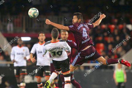 Nestor Araujo from Celta jumps for an air ball against opposition of Rodrigo Moreno Machado