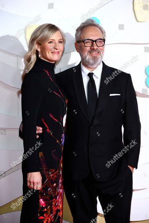 Sam Mendes and Alison Balsom pose for photographers upon arrival at the Bafta Film Awards, in central London