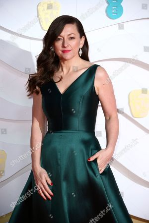 Jo Hartley poses for photographers upon arrival at the Bafta Film Awards, in central London