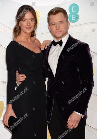 Stock Picture of Taron Egerton and Emily Thomas