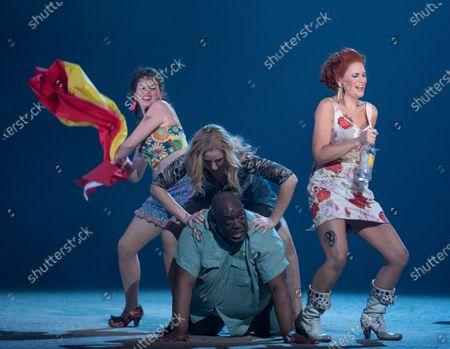 Stock Image of Ellie Laugharne as Frasquita, Justina Gringyte as Carmen, Keele Watson as Zuniga, Samantha Price as Mercedes