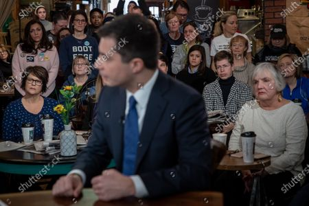 Voters watch as former Mayor of South Bend, Indiana Pete Buttigieg appears on 'AM Joy' on MSNBC with Joy Reid as he campaigns to be the 2020 Democratic presidential nominee at Java Joe's Coffeehouse in Des Moines, Iowa, USA, 02 February 2020. The first-in-the-nation Iowa caucuses are on 03 February 2020.