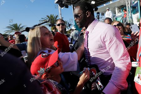 Stock Photo of Former NFL player Michael Vick greets fans before the NFL Super Bowl 54 football game between the San Francisco 49ers and Kansas City Chiefs, in Miami Gardens, Fla