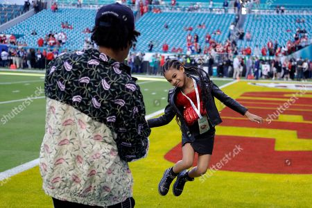 Entertainer Jay-Z watches his daughter Blue Ivy Carter leap on the field before the NFL Super Bowl 54 football game between the San Francisco 49ers and the Kansas City Chiefs, in Miami