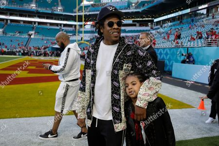 Entertainer Jay-Z stands with his daughter Blue Ivy Carter as they arrive for the NFL Super Bowl 54 football game between the San Francisco 49ers and the Kansas City Chiefs, in Miami