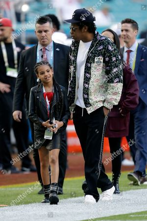 Entertainer Jay-Z walks with his daughter Blue Ivy Carter as they arrive for the NFL Super Bowl 54 football game between the San Francisco 49ers and the Kansas City Chiefs, in Miami