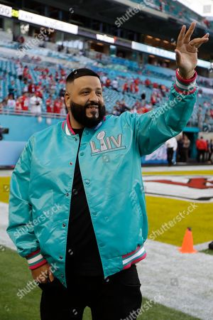 Stock Photo of DJ Khaled waves on the turf before the NFL Super Bowl 54 football game between the San Francisco 49ers and Kansas City Chiefs, in Miami Gardens, Fla