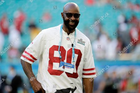 Former NFL player Jerry Rice walks on the field before the NFL Super Bowl 54 football game between the San Francisco 49ers and Kansas City Chiefs, in Miami Gardens, Fla
