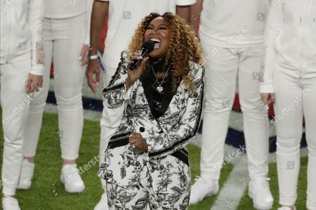"""Singer Yolanda Adams signs """"America the Beautiful"""", before the NFL Super Bowl 54 football game between the San Francisco 49ers and Kansas City Chiefs, in Miami Gardens, Fla"""