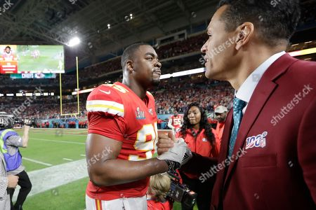Stock Image of Kansas City Chiefs' Chris Jones, left, celebrates with former NFL player Tony Gonzalez during the second half of the NFL Super Bowl 54 football game against the San Francisco 49ers, in Miami Gardens, Fla. The Kansas City Chiefs won 31-20