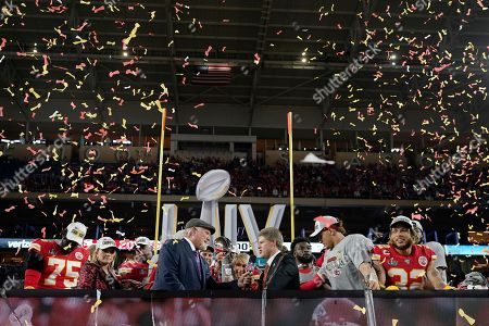 Broadcaster Terry Bradshaw, left, interviews Kansas City Chiefs Chairman Clark Hunt, right, after the Chiefsdefeated the San Francisco 49ers in the NFL Super Bowl 54 football game, in Miami Gardens, Fla