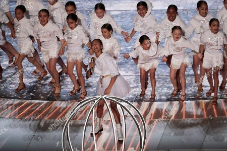 Emme Maribel Muniz, center, performs during halftime of the NFL Super Bowl 54 football game, in Miami Gardens, Fla