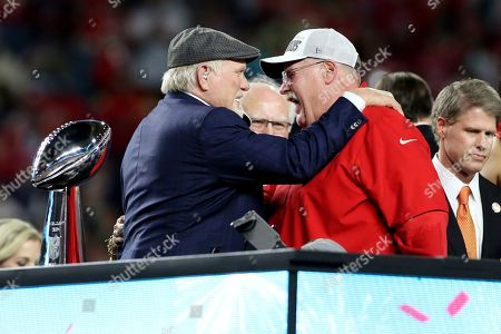 Kansas City Chiefs head coach Andy Reid is congratulated by Terry Bradshaw after a win against the San Francisco 49ers at Super Bowl 54, in Miami Gardens, Fla. The Chiefs won the game 31-20