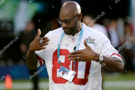 Former San Francisco 49ers wide receiver Jerry Rice walks on the field before the NFL Super Bowl 54 football game between the 49ers and Kansas City Chiefs, in Miami Gardens, Fla