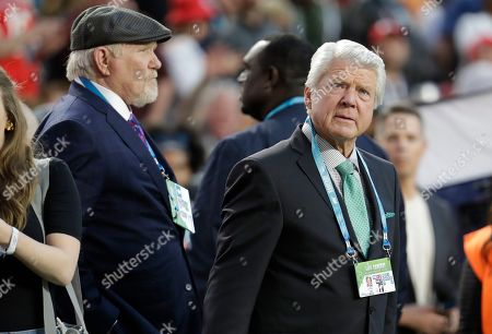Terry Bradshaw, left, and Jimmy Johnson watch teams warm up before the NFL Super Bowl 54 football game between the San Francisco 49ers and Kansas City Chiefs, in Miami Gardens, Fla