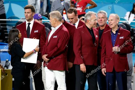 Tom Brady, John Elway, stands with Peyton Manning, Joe Montana, Brett Favre and Roger Staubach, from left, before the NFL Super Bowl 54 football game between the San Francisco 49ers and Kansas City Chiefs, in Miami Gardens, Fla