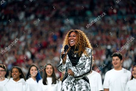 """Yolanda Adams performs """"America the Beautiful"""" during before the NFL Super Bowl 54 football game between the San Francisco 49ers and the Kansas City Chiefs, in Miami Gardens, Fla"""