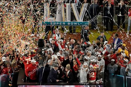 NFL Hall of Fame player Terry Bradshaw congratulates Kansas City Chiefs owner Clark Hunt and Norma Hunt after the team won the NFL Super Bowl 54 football game, in Miami Gardens, Fla. The Chief's defeated the San Francisco 49ers 31-20