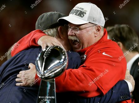 Kansas City Chiefs head coach Andy Reid receives congratulations from broadcaster Terry Bradshaw after defeating the San Francisco 49ers in the NFL Super Bowl 54 football game, in Miami Gardens, Fla