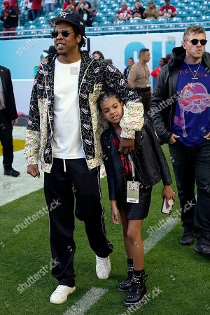 Entertainer Jay Z walks with his daughter Blue Ivy Carter as they arrive for the NFL Super Bowl 54 football game between the San Francisco 49ers and the Kansas City Chiefs, in Miami