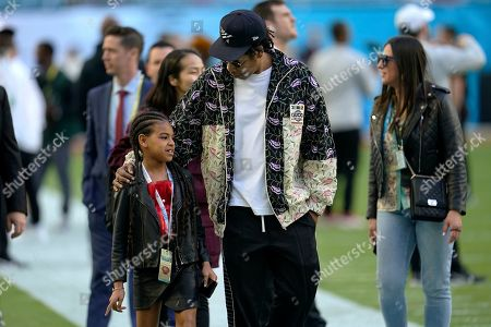 Entertainer Jay Z speaks with his daughter Blue Ivy Carter as they arrive for the NFL Super Bowl 54 football game between the San Francisco 49ers and the Kansas City Chiefs, in Miami