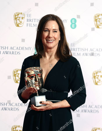 Kathleen Kennedy, winner of the BAFTA Fellowship, poses with her award, backstage at the Bafta Film Awards, in central London