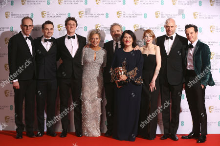 Stock Photo of From left, Callum McDougall, Charles Chapman, George MacKay, Jayne-Ann Tenggren, Sam Mendes, Pippa Harris, Krysty Wilson-Cairns, Mark Strong and Andrew Scott, winners of Best Film for 1917, backstage at the Bafta Film Awards, in central London