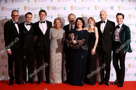 From left, Callum McDougall, Charles Chapman, George MacKay, Jayne-Ann Tenggren, Sam Mendes, Pippa Harris, Krysty Wilson-Cairns, Mark Strong and Andrew Scott, winners of Best Film for 1917, backstage at the Bafta Film Awards, in central London