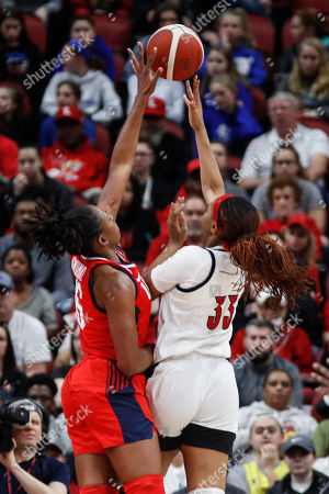 USA Women's National Team forward Nneka Ogwumike (16) blocks the shot of Louisville forward Bionca Dunham (33) during the first half of an exhibition basketball game, in Louisville, Ky
