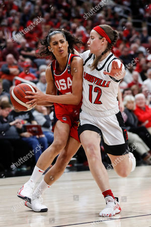 USA Women's National Team guard Skylar Diggins-Smith, left, drives against Louisville's Lindsey Duvall (12) during the second half of an exhibition basketball game, in Louisville, Ky