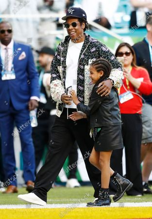 Stock Photo of US singer Jay-Z (L) and his daughter Blue Ivy (R) on the field hours before the NFC Champion San Francisco 49ers play the AFC Champion Kansas City Chiefs in the National Football League's Super Bowl LIV at Hard Rock Stadium in Miami Gardens, Florida, USA, 02 February 2020.