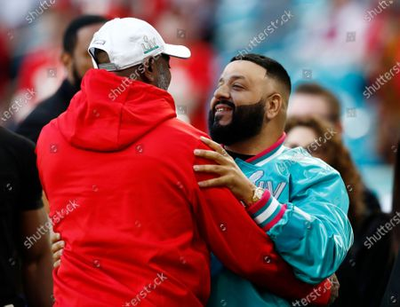 US singer DJ Khaled (R) greets someone on the field hours before the AFC Champion Kansas City Chiefs play the NFC Champion San Francisco 49ers in the National Football League's Super Bowl LIV at Hard Rock Stadium in Miami Gardens, Florida, USA, 02 February 2020.