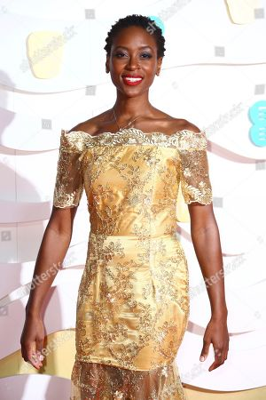 Tracy Ifeachor poses for photographers upon arrival at the Bafta Film Awards, in central London