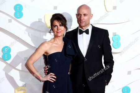 Mark Strong, Liza Marshall. Actor Mark Strong, right, and wife Liza Marshall pose for photographers upon arrival at the Bafta Film Awards, in central London