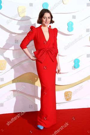 Gemma Whelan poses for photographers upon arrival at the Bafta Film Awards, in central London