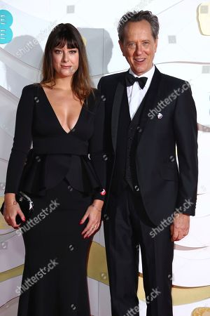 Richard E. Grant, Olivia Grant. Actor Richard E. Grant, right, and Olivia Grant pose for photographers upon arrival at the Bafta Film Awards, in central London