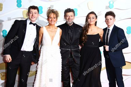 Stock Photo of Lorraine Ashbourne, Andy Serkis, Louis Serkis, Ruby Serkis, Sonny Serkis. Sonny Serkis, Lorraine Ashbourne, Andy Serkis, centre, Ruby Serkis and Louis Serkis pose for photographers upon arrival at the Bafta Film Awards, in central London