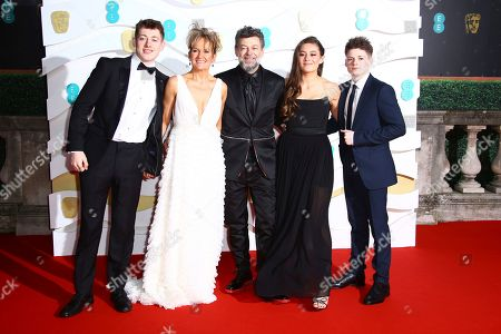 Stock Picture of Lorraine Ashbourne, Andy Serkis, Louis Serkis, Ruby Serkis, Sonny Serkis. Sonny Serkis, Lorraine Ashbourne, Andy Serkis, centre, Ruby Serkis and Louis Serkis pose for photographers upon arrival at the Bafta Film Awards, in central London