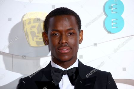 Actor Michael Ward poses for photographers upon arrival at the Bafta Film Awards, in central London
